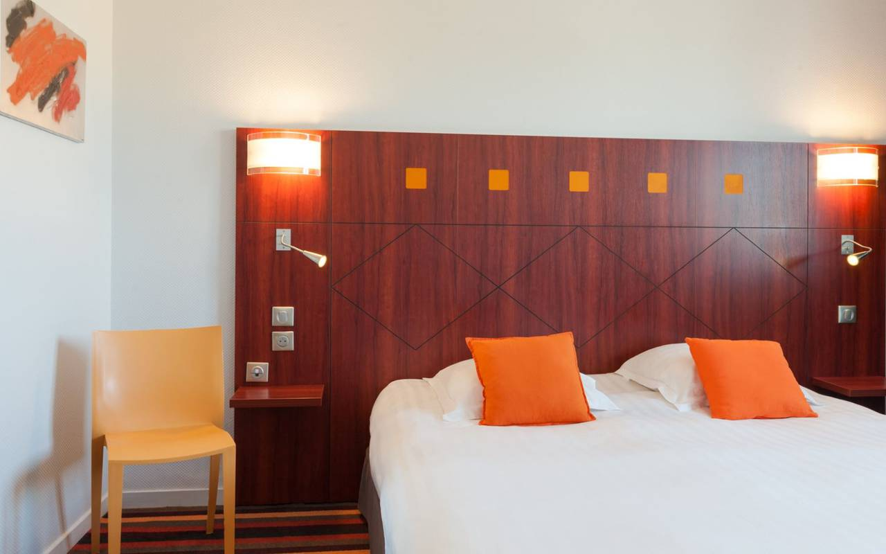 Bed at the hotel Le Pariou for a romantic weekend in Auvergne